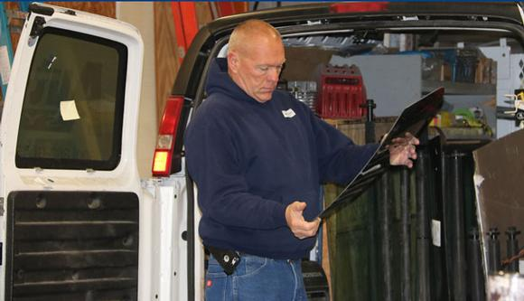 Picture of man repairing broken windshield at AutoGlass Systems in Springfield, Illinois